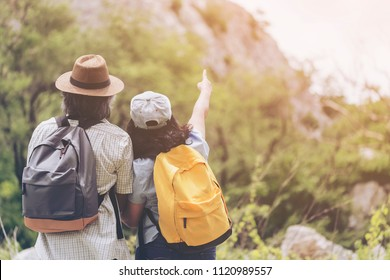 Happy travel together of Retired couple with backpack enjoying sunset on peak of mountain. Tourist traveler or Hiker looking sunlight in trip in Asia. Senior Retirement Family Happiness Concept