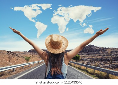 Happy travel woman on vacation concept with world shaped clouds. Funny traveler enjoy her trip and ready to adventure
