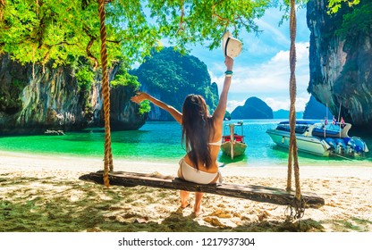 Happy traveler woman in bikini joy relaxing in beautiful nature scenic landscape island, Famous landmark travel Thailand summer fun beach, Tourism destination popular place Asia, Holiday vacation trip