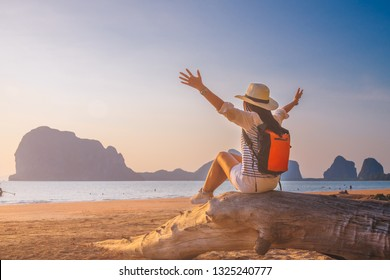 Happy traveler woman joy relaxing on summer vacation at sunset Pak Meng beach Trang, Leisure outdoor lifestyle tourist travel Thailand fun beach, Tourism beautiful destination place Asia holiday trips