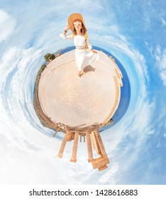 Happy traveler woman standing on a little planet and observing popular tourist landmark of ancient Acropolis in Greece. Unusual 360 degrees panoramic photo technique.