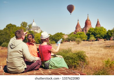 Happy travelers, friends, vacationers in the summer holidays in ancient Bagan, Myanmar.