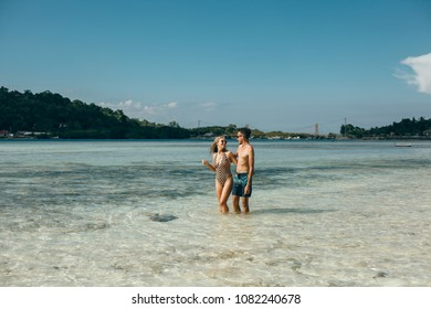 Happy traveling couple making selfie mountains background , sunny summer colors, romantic mood. Stylish sunglasses, straw hat. Happy laughing emotional faces Bali, couple in love, swimsuit, paradise