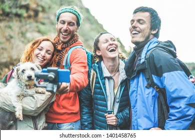 Happy trekkers people making video vlog for social network with gimbal phone - Young hiker friends having fun on mountain excursion day - Technology trends and sport concept - Focus on girls faces