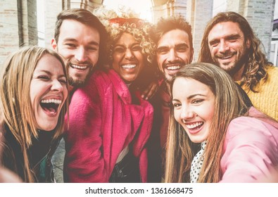 Happy trendy people making social network story with smartphone camera - Young fashion people having fun with new technology trend - Friendship, tech and youth lifestyle concept - Focus on center guys