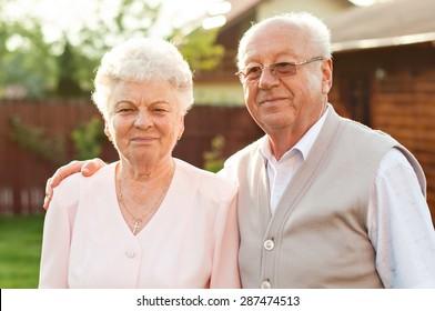 Happy trendy retired senior couple posing