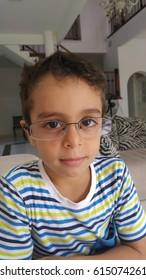 happy, trying on my new eyeglasses