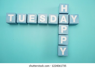 Happy Tuesday alphabet letters with space copy on blue background