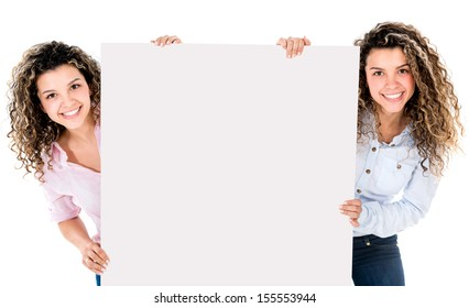 Happy twins holding a banner - isolated over white background