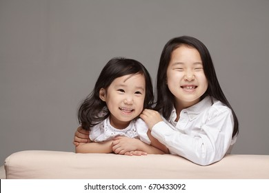 happy two asian sisters.
