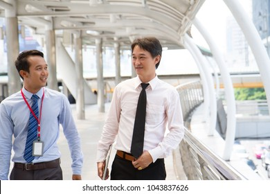 Happy Two businessmen are discussing their work in the morning in outdoor covered walkway