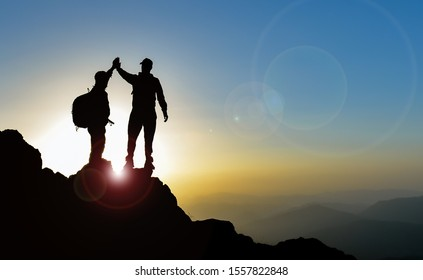 happy two climbers achievements on peak mountains
