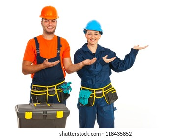 Happy two workers making presentation to right part of image isolated on white background