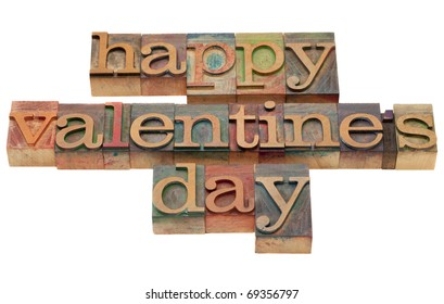 happy Valentine day wishes in vintage wooden letterpress printing blocks, stained by color inks, isolated on white