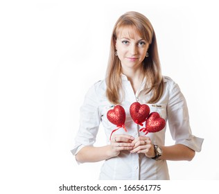 Happy Valentine Day! Young female with hearts in hands isolated on white