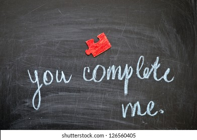 """Happy valentine, inscription by hand chalk """"you complete me."""""""