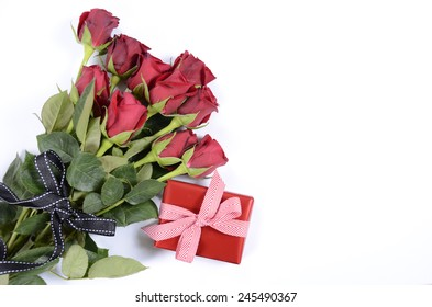 Happy Valentines Day bouquet of red roses with gift box on white background.