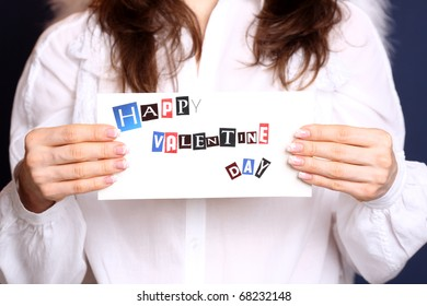 Happy Valentine`s day card in angel hands