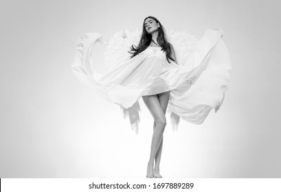 Happy Valentines Day. Valentines Day concept. Angel girl. Beautiful fairy flying girl in white dress. Angel woman with wings isolated
