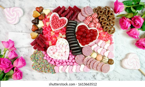 Happy Valentine's Day flat lay overhead candy and cookies dessert charcuterie grazing platter.