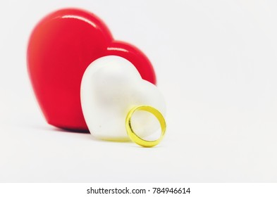 Happy Valentine's Day with Golden ring and White & Red Hearts isolated on White background