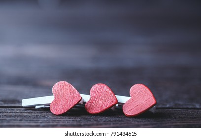 Happy Valentine's day hearts on wooden background. Valentines day greeting card.  love concept for mother's day and valentine's day