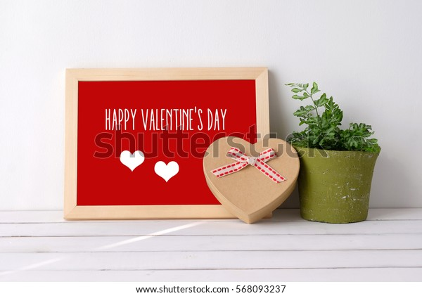 Happy valentine's day on wood board and heart shape gift box on white background, valentine's day card, banner
