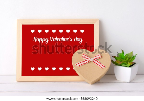 Happy valentine's day on wood board and heart shape gift box on white background, with copy space for text, valentine's day card, banner