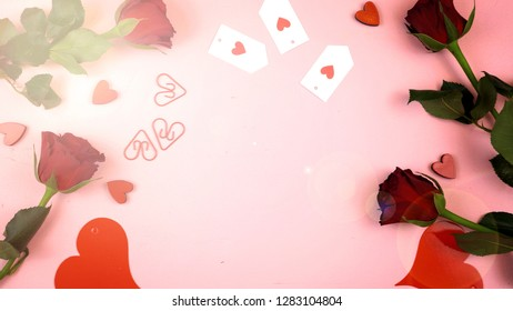 Happy Valentine's Day overhead flat lay wrapping gift and writing cards.