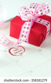 Happy Valentine's day written on calendar with red gift box
