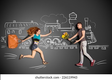 Happy valentines love story concept of a romantic couple meeting at the railway station against chalk drawings background.