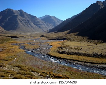 Happy valley in Tibet, one bedroom apartment in Kailash, in the foreground is the winding mountain river, pyramidal mountains around.
