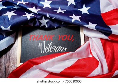 Happy Veterans Day. American flag with text on card .