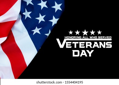 Happy Veterans Day with American flags on dark background.