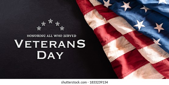 Happy Veterans Day concept. Vintage American flags against blackboard  background. November 11.