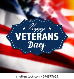 Happy Veterans Day sign on USA flag background