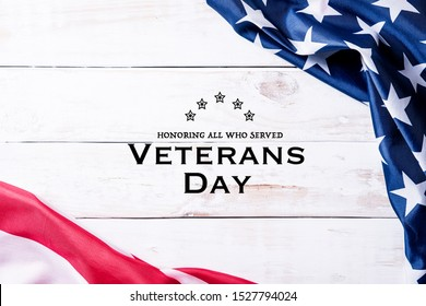 Happy Veterans Day. Top view of Flag of the United States of America with the text thank you veterans against on white wooden background. November 11.