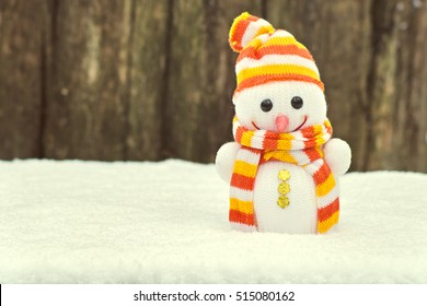 Happy Vintage Snowman Toy On The Bokeh Winter Background In Snow Cute