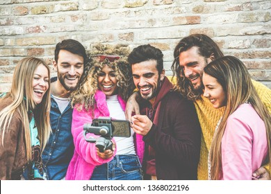 Happy vlogger making video feed with friends using smartphone outdoor - Young people having fun with new technology trends - Youth lifestyle and social media concept - Focus on center guys faces