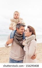 happy walking family enjoying season