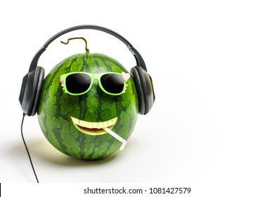 happy watermelon face with headphones on listening to music.
