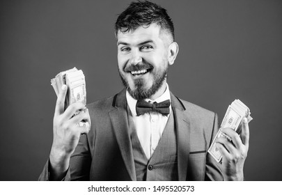 Happy and wealthy. Rich businessman with us dollars banknotes. Bearded man holding cash money. Currency broker with bundle of money. Making money with his own business. Business startup loan.