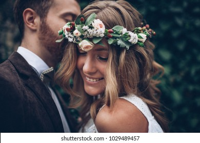 Happy wedding couple. Bride with flowers in hair.