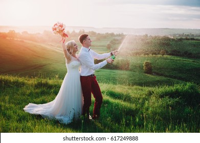 https://image.shutterstock.com/image-photo/happy-wedding-couple-buttle-champaine-260nw-617249888.jpg