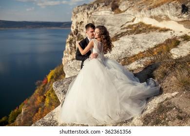 happy wedding couple on the edge of the world. extreme wedding