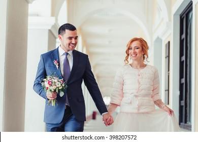 Happy Wedding couple walking and smiling