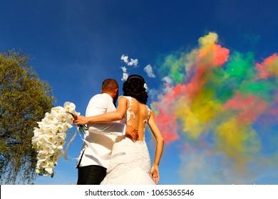 Happy wedding couple watching fireworks. Wedding day