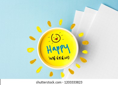 Happy weekend quote and coffe cup on blue background. Time to break concept.