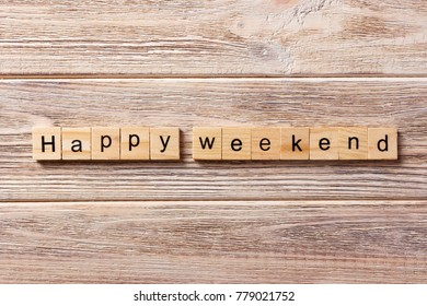 happy weekend word written on wood block. happy weekend text on table, concept.