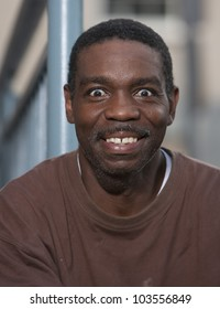 Happy and wide eyed african american man portrait